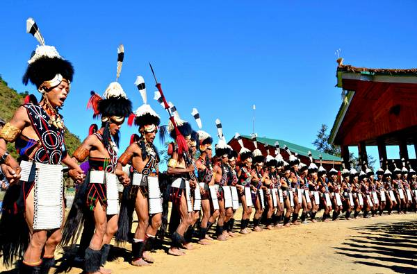 Kohima, India. 2nd December 2012 -- Naga tribesmen dressed in traditional costumes perform on the second day of the state annual Hornbill festival at Kisama. -- The week long Hornbill Festival of Nagaland, which celebrates the cultural heritage of the sixteen Naga tribes continues in Kohima India.